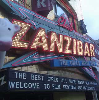Zanzibar club web Stock traders and strippers photo