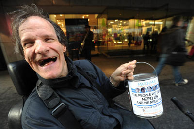 Muki Baum Man with disability raises $600K as street beggar photo