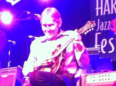 Levon Helm on mandolin at Harvest Blues and Jazz Festival 2011 (photo Stephen Pate)
