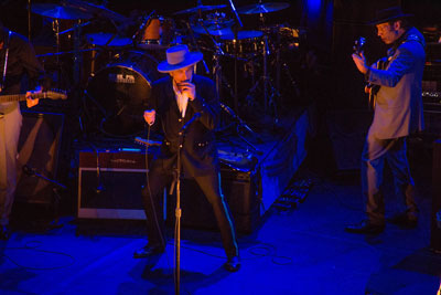 Bob Dylan, on the harmonica, performing in Argentina April 2012 (Photo Adrian Lasso, Creative Commons)
