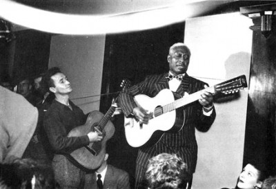 Woody Guthrie with a Martin 0-17 playing with Leadbelly, 1941 NYC