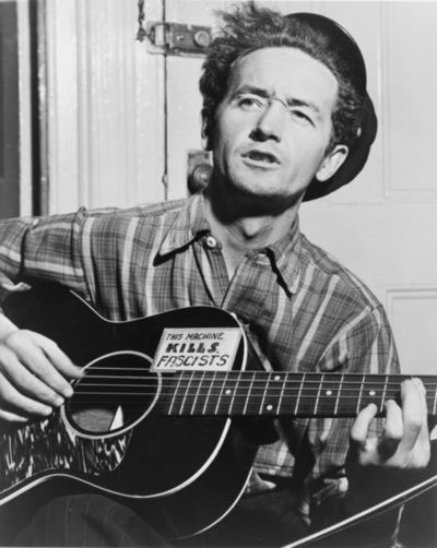 Woody Guthrie guitar kills Fascists1 What Guitar Did Woody Guthrie Play? photo
