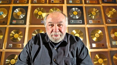 Bernie Finkelstein with a few of his record awards (CBC photo)