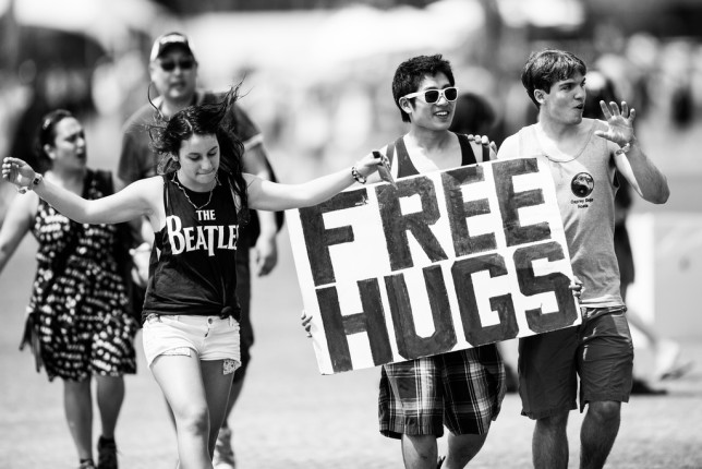 Fans get into the mood with free hugs at Coachella 2013 (photo Thomas Hawk, Creative Commons license, some rights restricted)